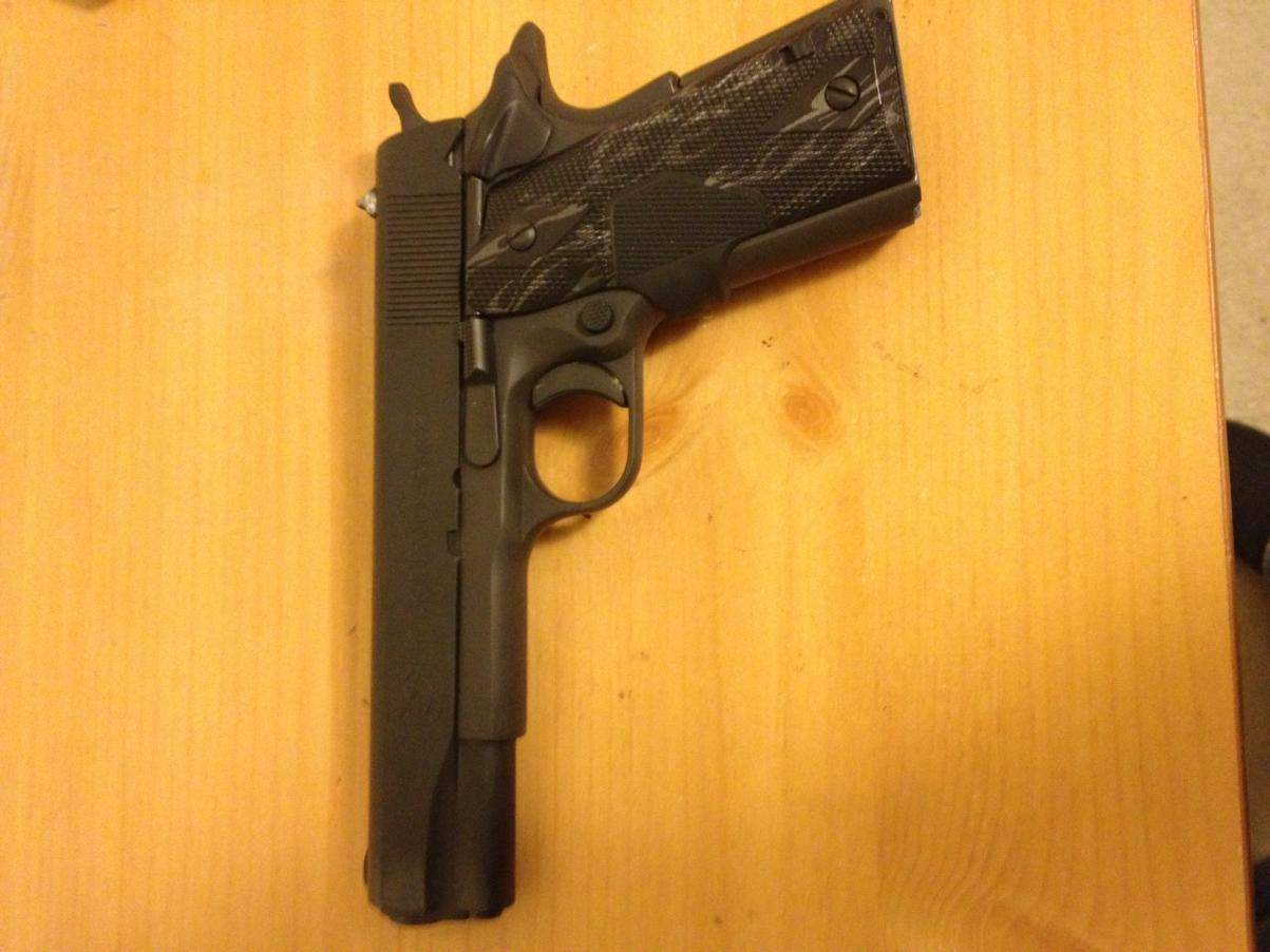 RIA Full-size GI 1911 with Crimson Trace grips and 9